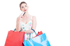 Woman at shopping holding a credit debit card Royalty Free Stock Photos