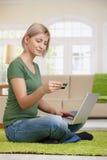 Woman shopping on internet Stock Photos