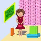 Woman with shopping in the house. Young girl did a lot of shopping and brought it all home Stock Image