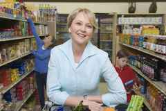 Woman Shopping With Kids In Supermarket Stock Photography