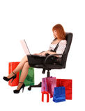 Woman   shopping on-line. Beautiful, young, redhead woman woman   shopping on-line Stock Image