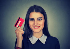 Woman shopping on line holding showing credit card Royalty Free Stock Photography