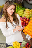 Woman with a shopping list Royalty Free Stock Images
