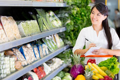Woman shopping with a list Stock Photo