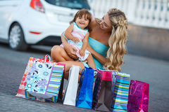 Woman during the shopping with the little girl Royalty Free Stock Photography