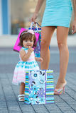 Woman during the shopping with the little girl Stock Photos