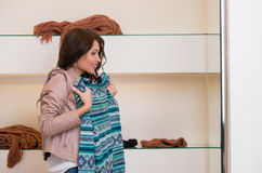Woman shopping and looking in mirror uncertain Stock Photography