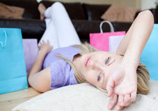 Woman after shopping lying on the floor Stock Image
