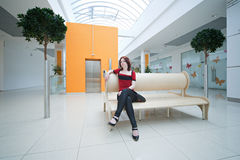 Woman in  shopping mall. With lift Royalty Free Stock Photo