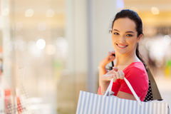 Woman shopping in mall. Happy young woman shopping in mall Stock Photos