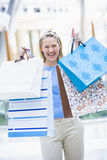 Woman shopping in mall. Holding bags Stock Image