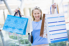 Woman shopping in mall. Holding bags Stock Photos