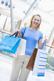 Woman shopping in mall. Carrying bags Stock Image