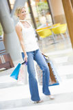 Woman shopping in mall. Woman shoppping in mall with bags Stock Images