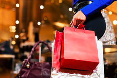 Woman shopping in Mall with bags. Woman in a shopping mall with colorful bags Royalty Free Stock Photos