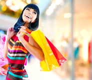 Woman in Shopping Mall. Beauty Woman with Shopping Bags in Shopping Mall Stock Photography