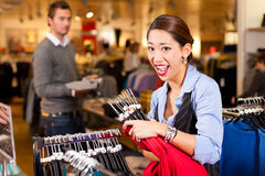 Woman in a shopping mall with clothes Royalty Free Stock Image