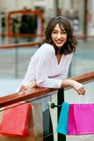 Woman In Shopping Mall. Female With Colorful Bags Having Fun In Shopping Centre. High Resolution Royalty Free Stock Photo