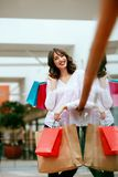 Woman In Shopping Mall. Female With Colorful Bags Having Fun In Shopping Centre. High Resolution Royalty Free Stock Photography