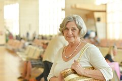 Woman in shopping mall. Happy cute senior woman in shopping mall Stock Photo