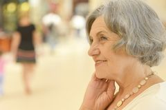 Woman in shopping mall. Portrait of happy senior woman in shopping mall Stock Image