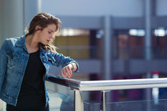 Woman in a shopping mall. Pretty stylish woman walking in a shopping mall Royalty Free Stock Photos
