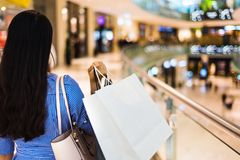 Woman in a shopping mall. Rear view Royalty Free Stock Photo