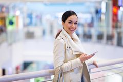 Woman in shopping mall. Young beautiful woman shopping in mall Royalty Free Stock Photography