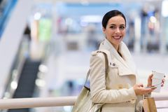 Woman in shopping mall. Young beautiful woman shopping in mall Stock Images