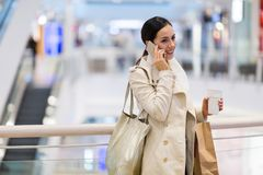 Woman in shopping mall. Young beautiful woman shopping in mall Stock Photo