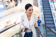 Woman in shopping mall. Young beautiful woman shopping in mall Royalty Free Stock Image