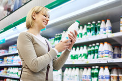 Woman shopping milk Royalty Free Stock Images