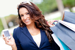 Woman shopping with a mobile phone Royalty Free Stock Photography