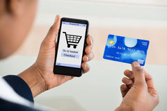Woman Shopping On Mobile Phone Royalty Free Stock Photography