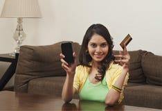 Woman shopping on a mobile phone Stock Photos