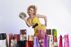 Woman with shopping and money Stock Images