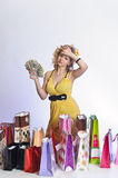 Woman with shopping and money Royalty Free Stock Photography
