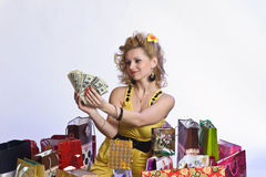 Woman with shopping and money Stock Photography
