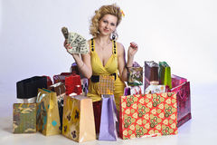 Woman with shopping and money Royalty Free Stock Photo