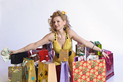 Woman with shopping and money Stock Photos