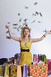 Woman with shopping and money Royalty Free Stock Image