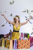 Woman with shopping and money Stock Image