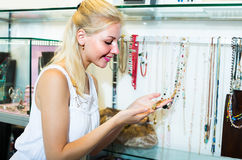 Woman shopping necklace Royalty Free Stock Images