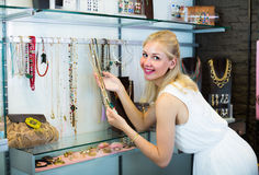 Woman shopping necklace Stock Images