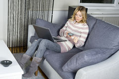 Woman shopping online Stock Photography