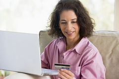 Woman Shopping Online. Woman making online purchase with credit card Royalty Free Stock Image