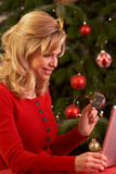 Woman Shopping Online For Christmas Gifts Royalty Free Stock Photos