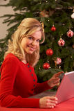 Woman Shopping Online For Christmas Gifts Royalty Free Stock Image