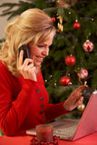 Woman Shopping Online For Christmas Gifts On Phone Royalty Free Stock Photo