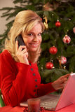 Woman Shopping Online For Christmas Gifts On Phone Stock Photos